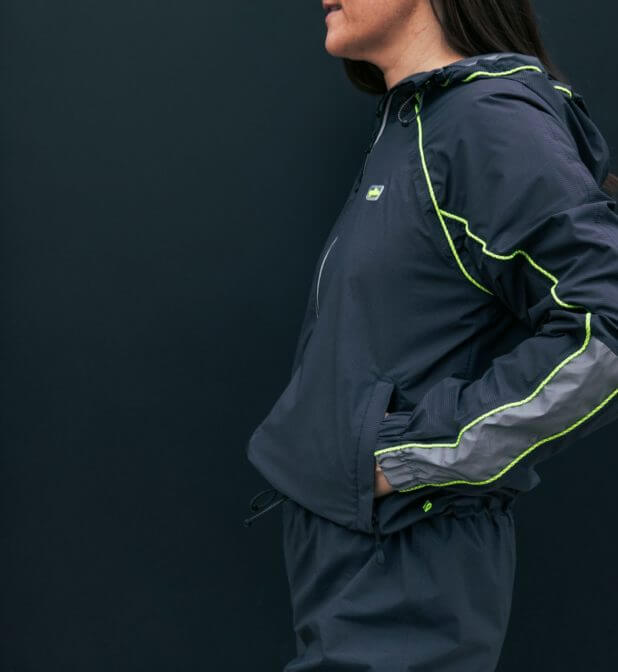 """Close-up of waterproof jumpsuit """"Oneway"""" with neon and reflective strokes."""